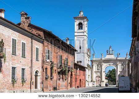 Cherasco,Italy,Europe - May 3, 2016 : View of the Triumphal Arch, the Sant Agostino church and its bell tower