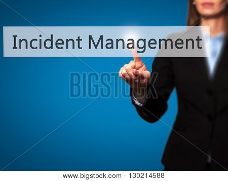 Incident Management - Businesswoman Hand Pressing Button On Touch Screen Interface.
