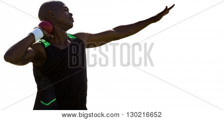 Profile view of sportsman practising shot put