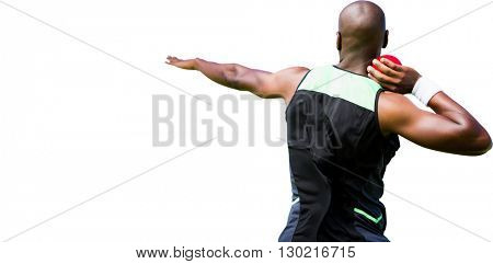 Rear view sportsman practising shot put