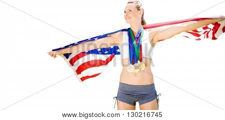 Portrait of happy sportswoman with medals holding american flag
