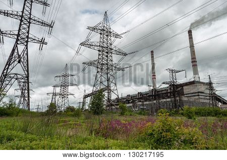 Old Coal power plant with gray sky