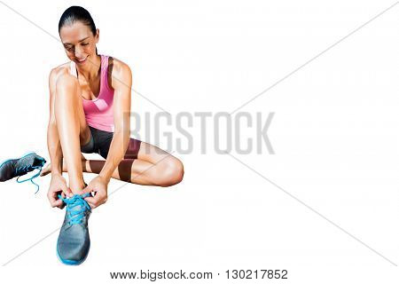 A sporty woman doing her shoelace