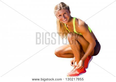 Sporty woman doing her shoelace