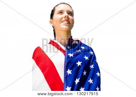 Low angle view of sporty woman holding a American flag