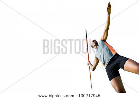 Low angle view of athletic man preparing his javelin throw