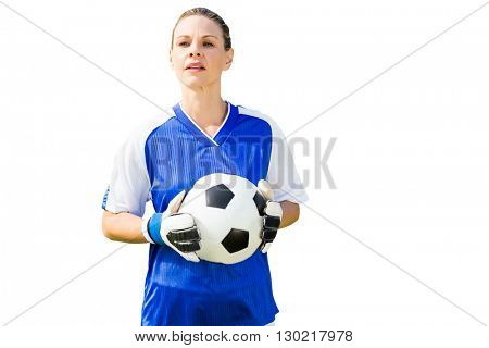 Woman goalkeeper posing with a ball