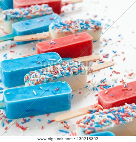 Colorful frozen popsicles in redwhite and blue with sprinkles