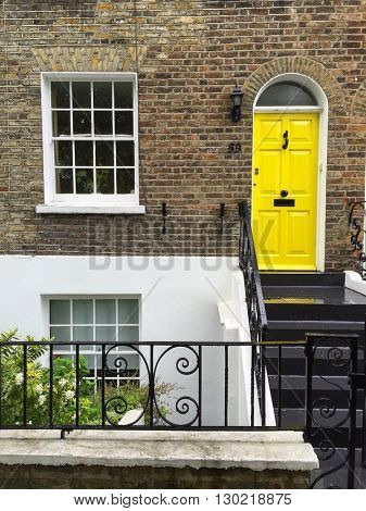 LONDON - MAY 18: Smart house entrance with yellow front door on May 18, 2016 in Hampstead, London, UK.