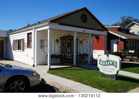 PLAINFIELD, ILLINOIS / UNITED STATES - SEPTEMBER 20, 2015: One may have one's hair cut at Kelly's Compete Family Hair Styling in downtown Plainfield.
