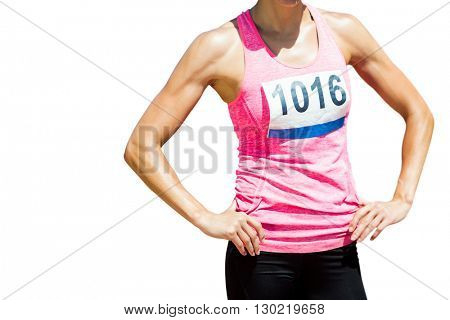 Portrait of sportswoman chest is posing with hands on hips