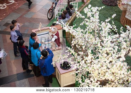 MOSCOW - APRIL 13: People buy ice cream in GUM store on April 13 2016 in Moscow. GUM is the large store in the Kitai-gorod part of Moscow facing Red Square.