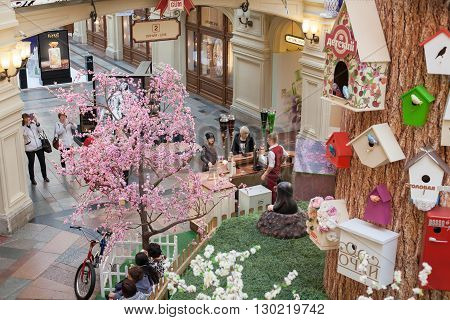 MOSCOW - APRIL 13: The interior decorated artificial tree and birdhouses in GUM store on April 13 2016 in Moscow. GUM is the large store in the Kitai-gorod part of Moscow facing Red Square.