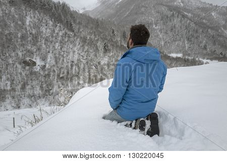 Praying man, Man is praying seating in the snow around of mountains