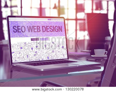 Modern Workplace with Laptop Showing Landing Page in Doodle Design Style with Text  SEO - Search Engine Optimization - Web Design. Toned Image with Selective Focus. 3D Render.