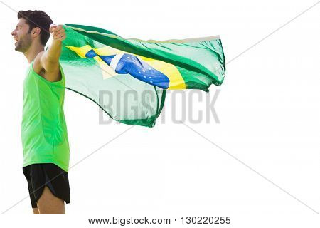Profile view of Brazilian sportsman is holding a flag