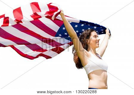 Profile view of sportswoman is raising an american flag