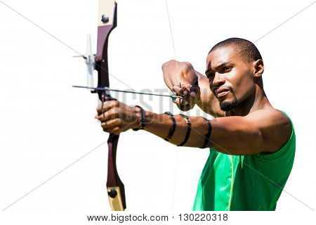 Rear view of american sportsman is posing Close up view of man practicing archery