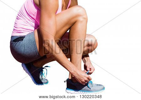 Close up of sportswoman is lacing shoes