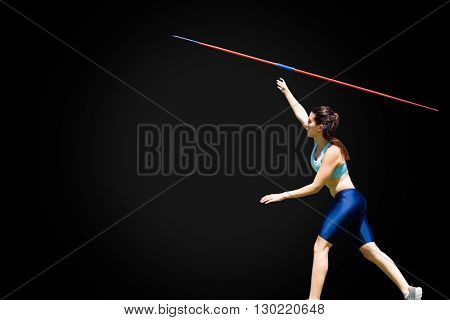 Profile view of sportswoman is practising javelin throw
