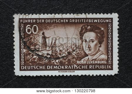ZAGREB, CROATIA - JULY 02: a stamp printed in GDR shows Rosa Luxemburg, Marxist theorist, philosopher, economist and revolutionary socialist, circa 1955, on July 02, 2014, Zagreb, Croatia