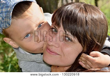 Little Boy Hugging And Kissing His Mother, Close-up