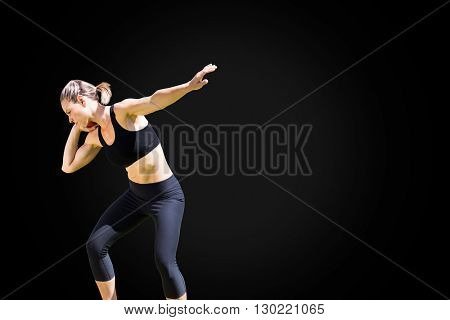 Front view of sportswoman is practising shot put