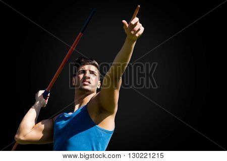 Low angle view of sportsman practising javelin throw