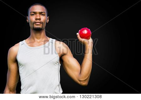 Portrait of serious sportsman is holding a shot put