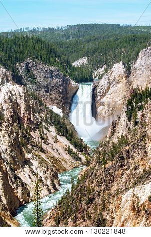 The Grand Canyon of the Yellowstone is a unique sight with varicolored striations visible on the rock canyon walls almost like a rainbow of different rust-colored shades.