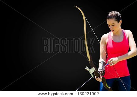Athletic woman practicing archery