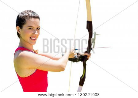 Portrait of sportswoman is smiling and practising archery