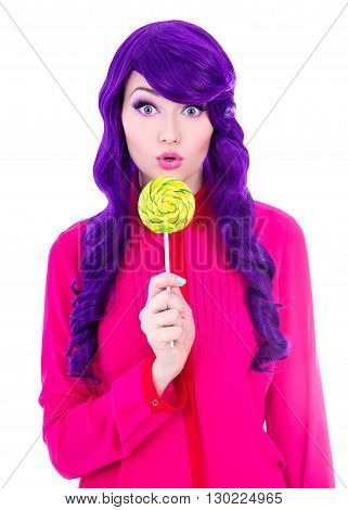Portrait Of Surprised Woman With Purple Hair Wig Holding Colorful Lollipop Isolated On White