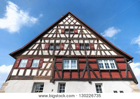 Upper part of an old, restored, Swabian half-timbered house with German inscription. Taken in Bickelsberg, Germany.
