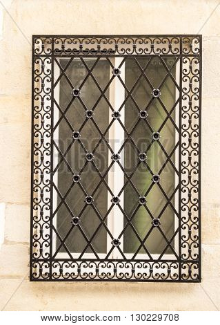 Decorative wrought iron window grill in France