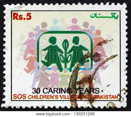 PAKISTAN - CIRCA 2005: a stamp printed in Pakistan dedicated to SOS Children's Villages in Pakistan, 30th Anniversary, circa 2005