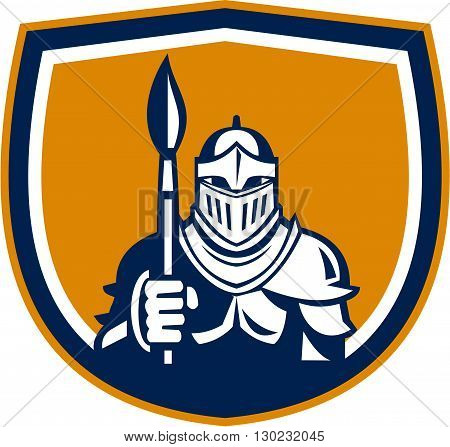 Illustration of knight in full armor holding paint brush viewed from front set inside shield crest on isolated background done in retro style.