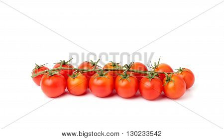 Tomatoes cherry branch isolated on white background.