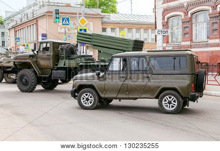 SAMARA RUSSIA - MAY 9 2016: Special armored vehicle UAZ-3152 Hussar and BM-21 Grad Multiple Rocket Launcher on Ural-375D chassis at the street during the parade on Victory Day