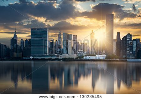 New York City skyline with urban skyscrapers at sunset USA.