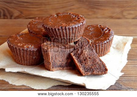 Chocolate sweet homemade cupcakes. Sweet pastries. Delicious chocolate cupcakes. Baking recipe. Closeup