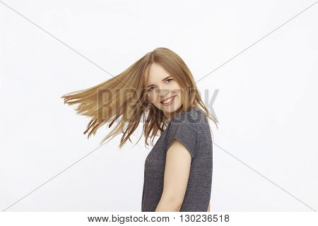 portrait of Happy Young Woman with long scattered hair