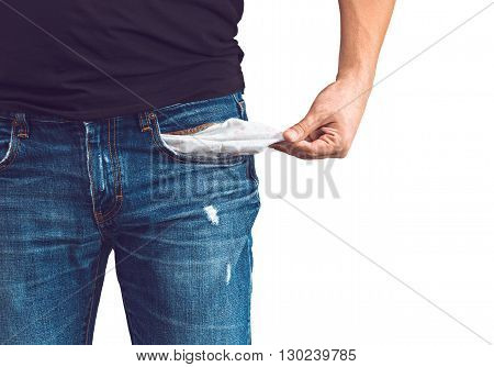 Poor man in jeans with empty pocket isolated on white