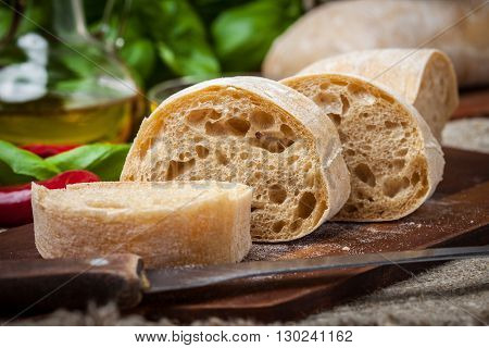 Sliced Ciabatta Bread On Cutting Board.