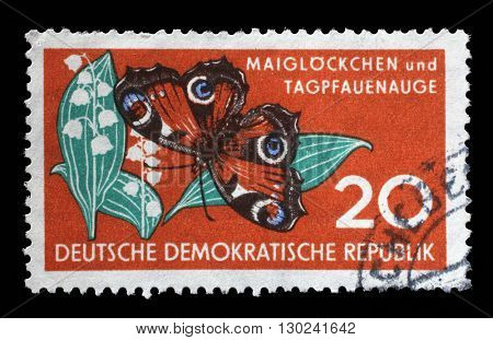 ZAGREB, CROATIA - JULY 02: a stamp printed in GDR shows Lily of the Valley and Butterfly, Nature, circa 1959, on July 02, 2014, Zagreb, Croatia