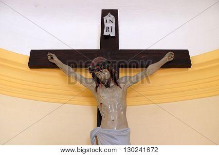 STITAR, CROATIA - AUGUST 27: Crucifix in the chapel in the village Stitar, Croatia on August 27, 2015