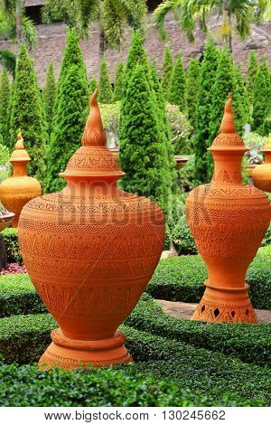 Clay vase in the Park on a background of trees.