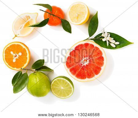 View from above of citrus fruit ( lime lemon orange grapefruit and tangerine) with leaves and flowers isolated on white background.