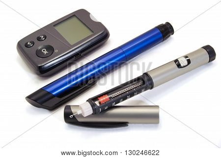 Insulin pen and glucometer for diabetics on a clean white background