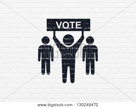 Political concept: Painted black Election Campaign icon on White Brick wall background